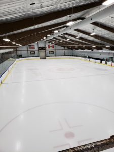 Post LED conversion picture of John Lindell Ice Arena.