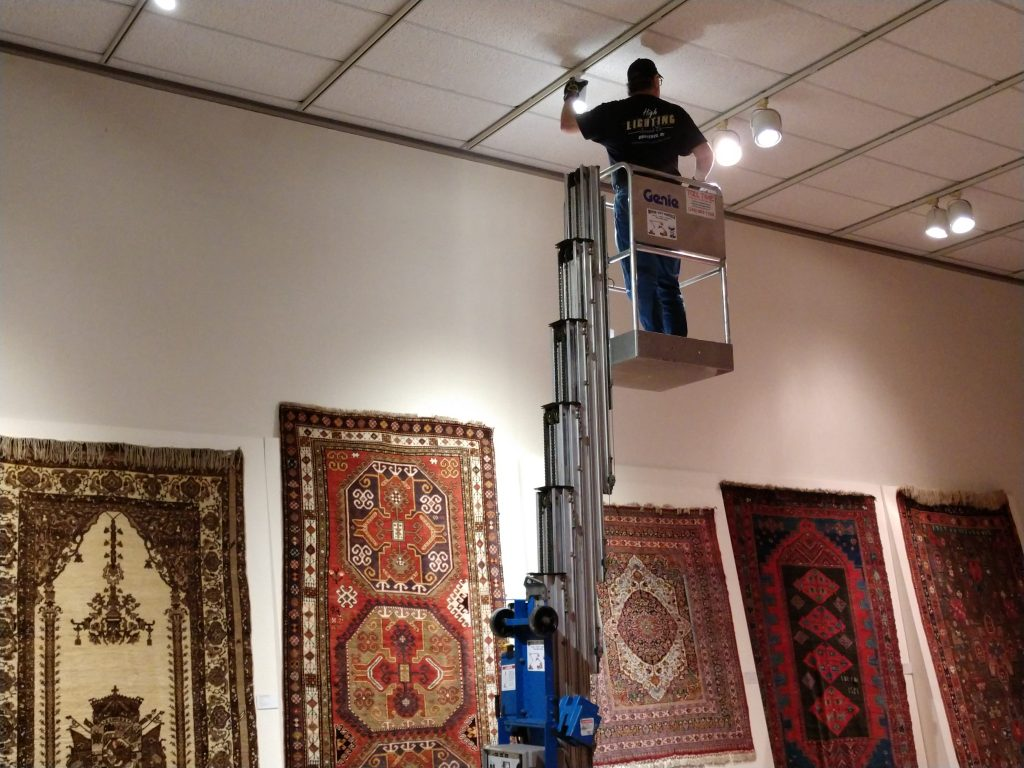 Eddie is installing the new LED fixtures in the carpet room.